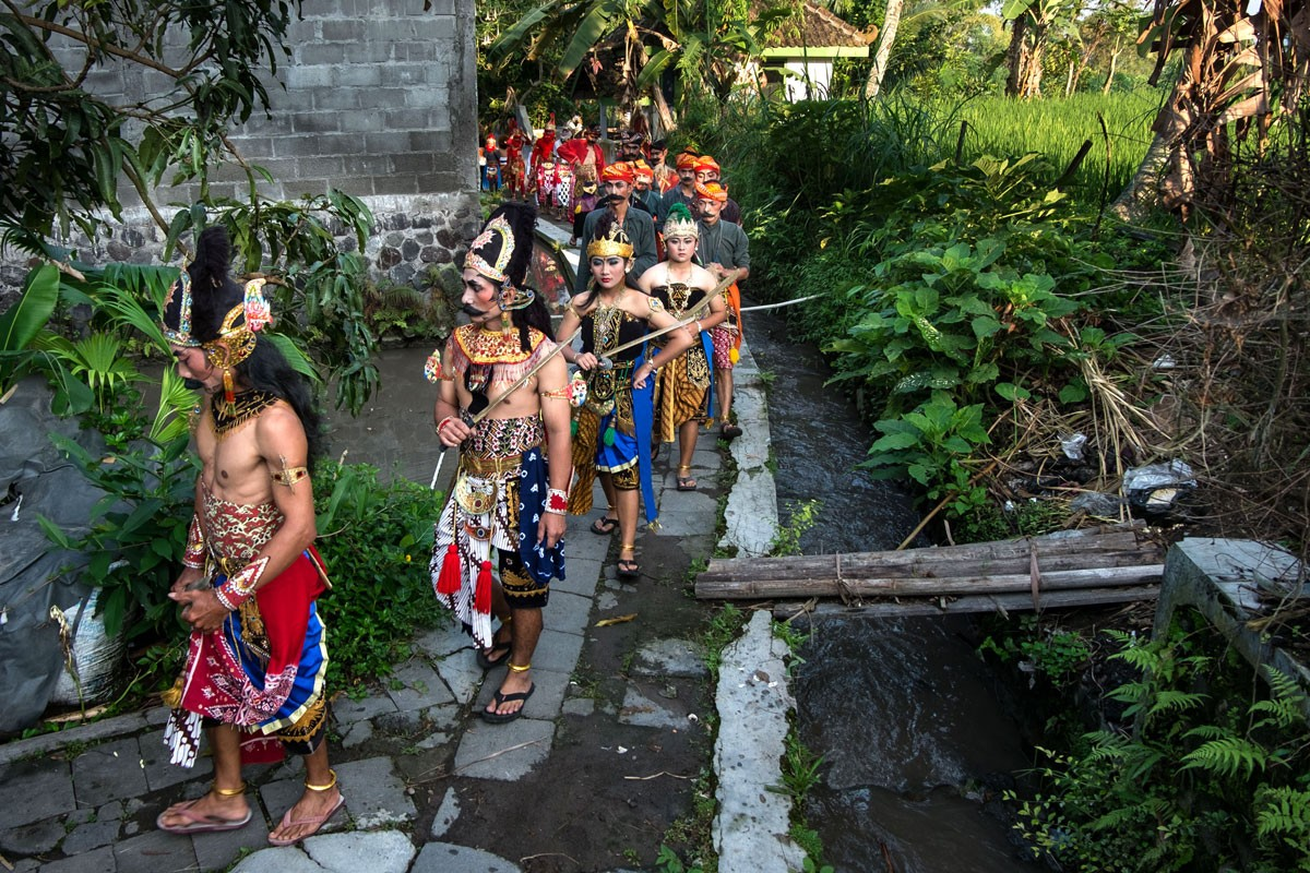 All participants of the arts performance walk around Tutup Ngisor village in the foothills of Mount Merapi in Central Java during a Suro ritual.