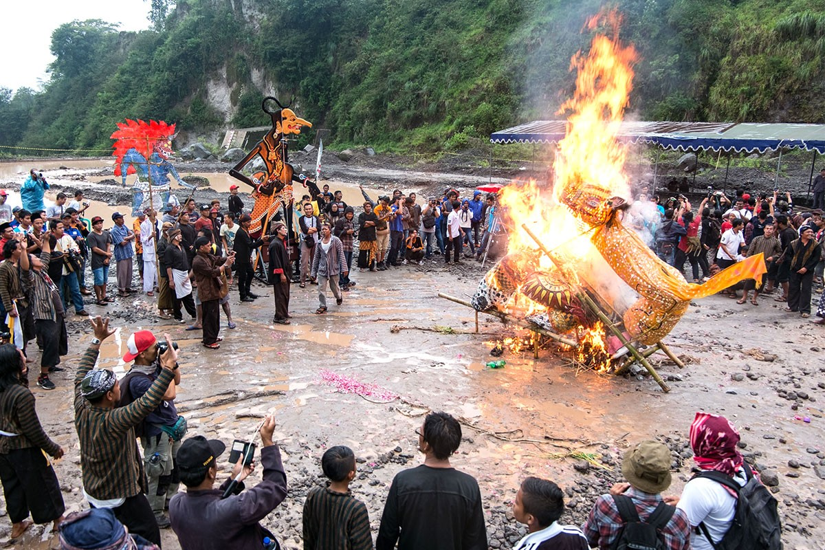 The burning of an effigy of a wild hog serves to drive away bad luck.  JP/ Tarko Sudiarno