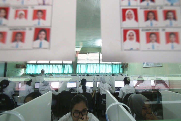 Several students take the computer-based National Examination at SMAN 70 High School in Jakarta on Monday. There are 63,883 high-school-level students in Jakarta writing the computer-based national exam on Monday out of 133,961 high school and equivalent-level students.