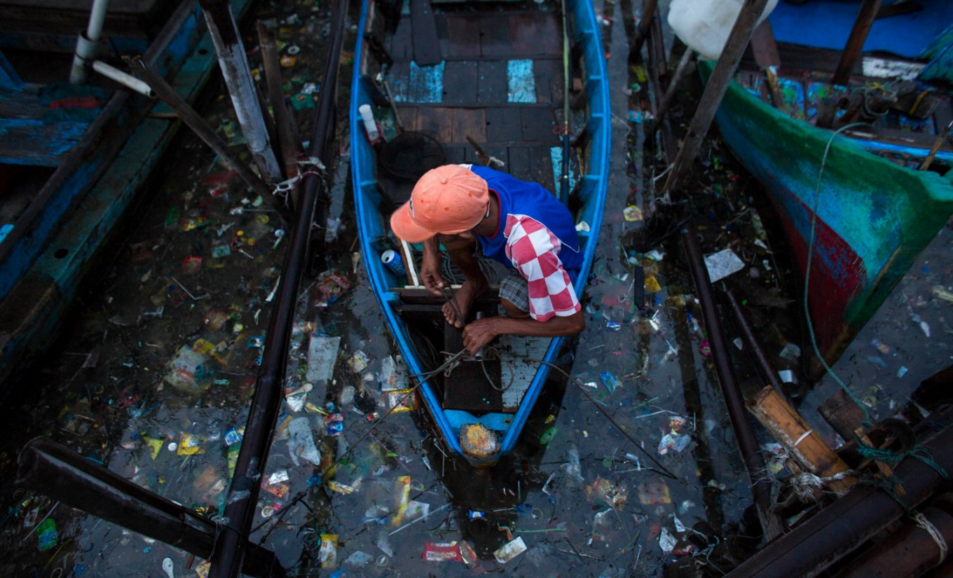 Photo exhibition rings alarm bells over Jakarta flooding