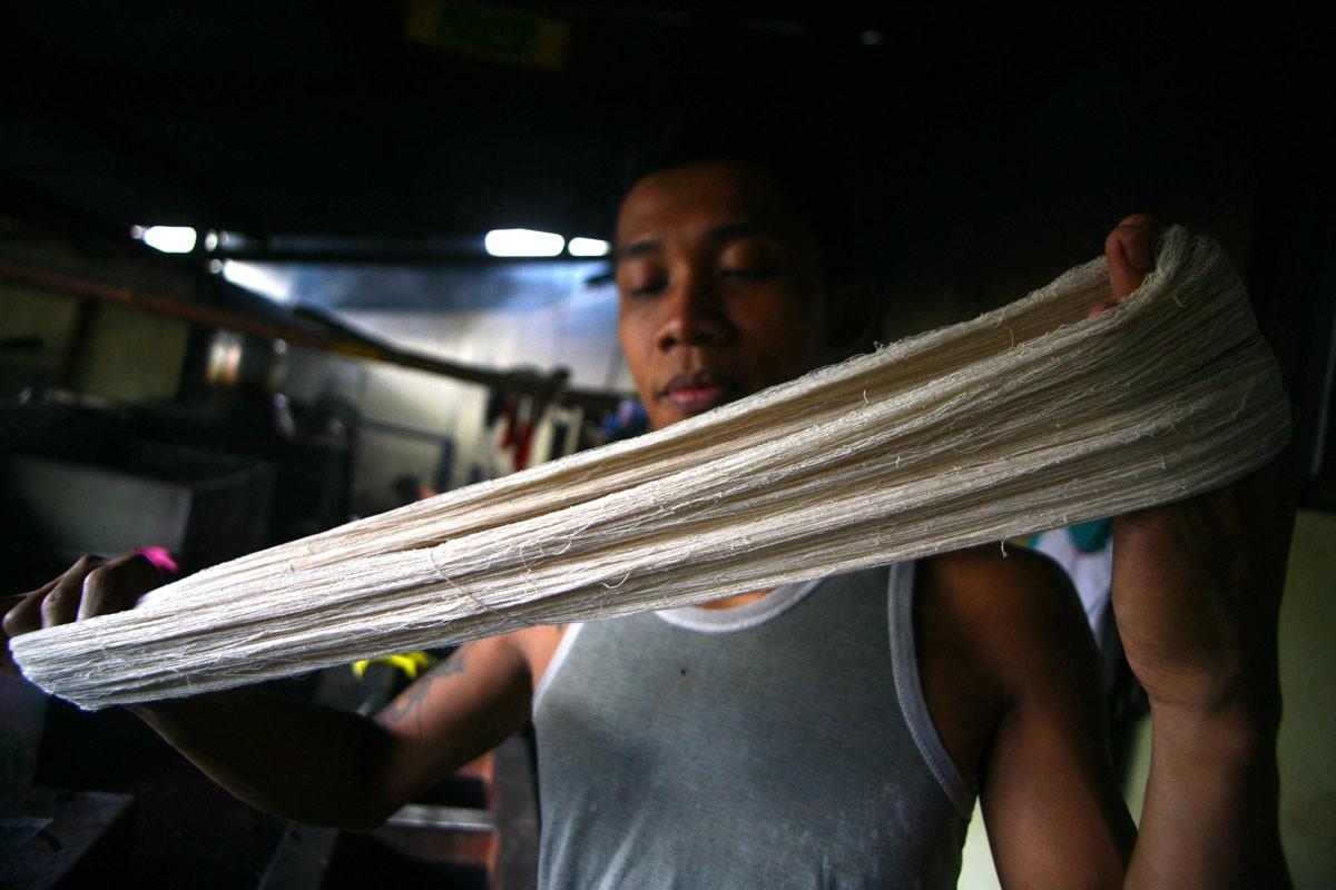 A worker tidies up the skeins of yarn before dyeing them. JP/Aditya Sagita