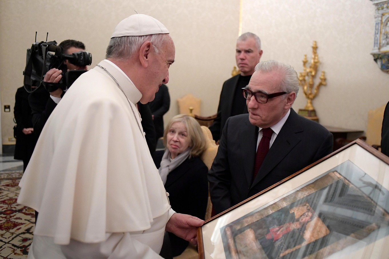 Girl meets pope and promptly steals his hat