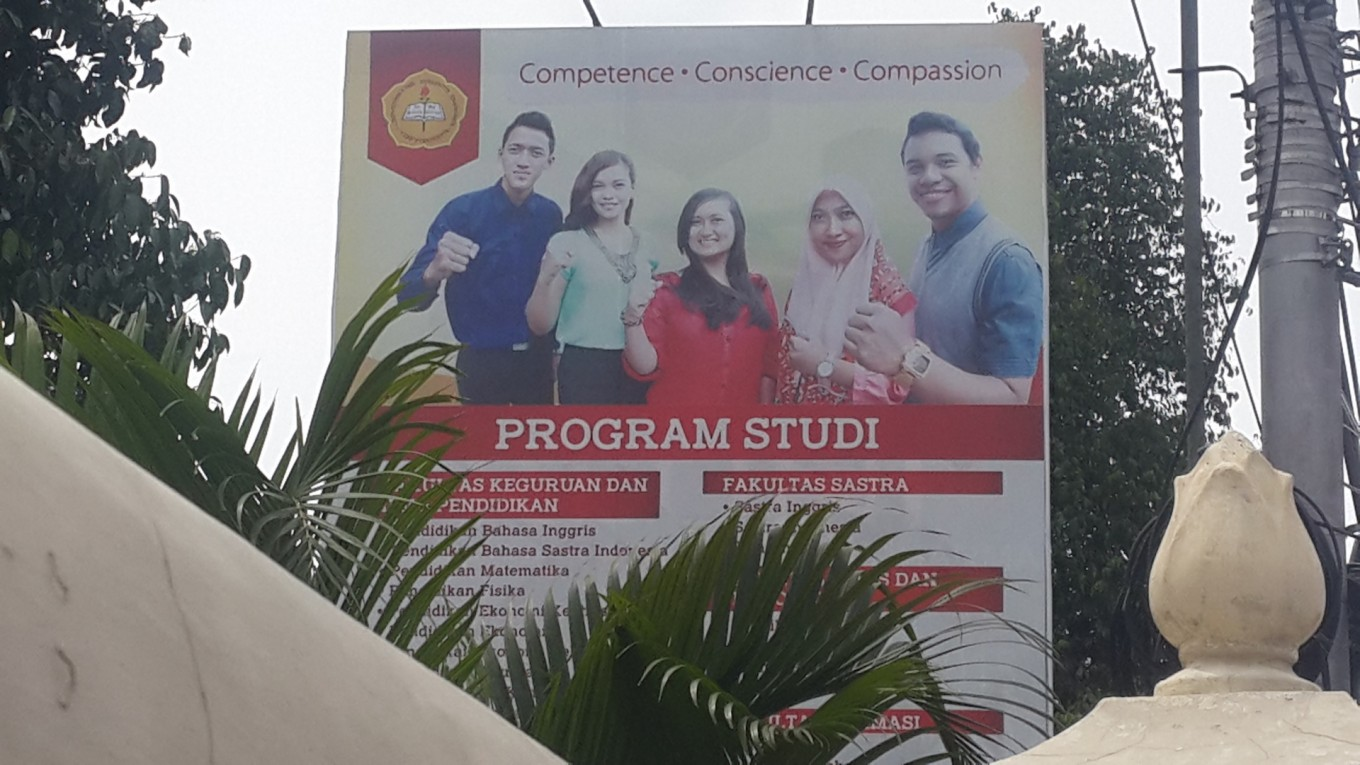 FUI forces Christian university to drop billboard with hijab-clad student