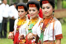 Colorful: Women of Toraja showcase their traditional costume when welcoming guests. JP/ PJ Leo