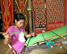 Work in progress: A teenager creates Toraja's renowned woven fabric in Sa'dan and To'Barana in Sa'dan and Malimbong villages in North Toraja. JP/ PJ Leo