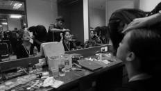 Two dancers get ready in hair and makeup before a press preview at Teater Besar on Dec. 1.
