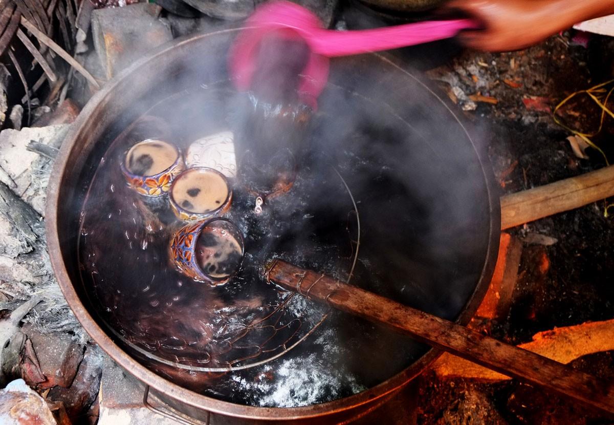 Artisans carry out pelorodan, the process of removing the wax to make the colors more vibrant. JP/Ganug Nugroho Adi