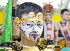 The Stare: With full make-up, a boy dressed up in a costume is ready to participate in the Twin Temple Festival in Candi Plaosan, Central Java. JP/ Magnus Hendratmo