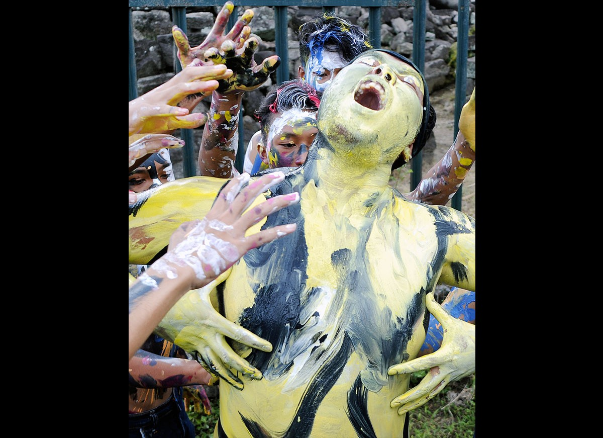 In Trance: A man, his body smeared in paint, enjoys the music while surrounded by others. JP/ Magnus Hendratmo
