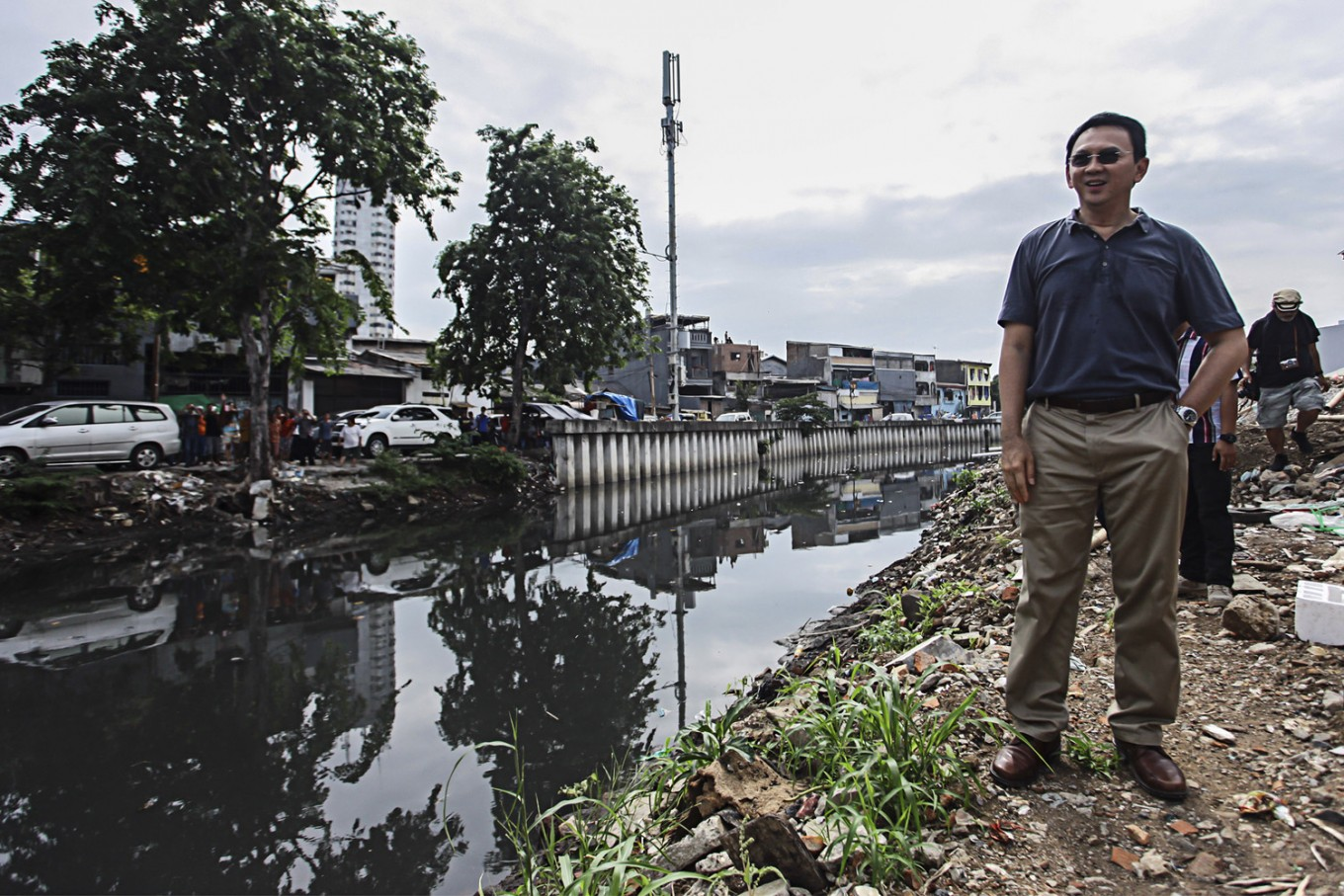 Ahok apologizes to residents still affected by flooding