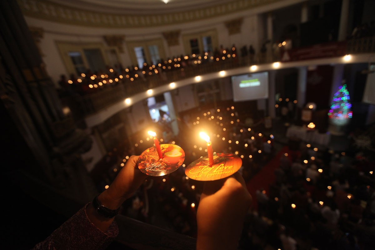Christians at the Protestant Church Immanuel in Central Jakarta celebrate Christmas Eve by lighting candles. JP/Donny Fernando