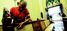 One by one: Samin, 69, patiently fixes a rattan benchin the Jakarta Cathedral in Central Jakarta. JP/ Donny Fernando