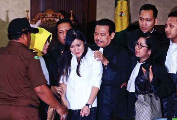 Guilty as charged: Jessica Kumala Wongso is consoled by her lawyers after judges found her guilty of murder at the Central Jakarta Court on Oct. 27. Jessica was sentenced to 20 years in