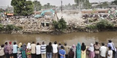 In ruins: People watch the razing of slum dwellings built along the Ciliwung River in Jakarta on Sept. 28. The city administration relocated the residents to low-cost apartments to make way for the river's development program in an effort to tackle the city's persistent flooding.