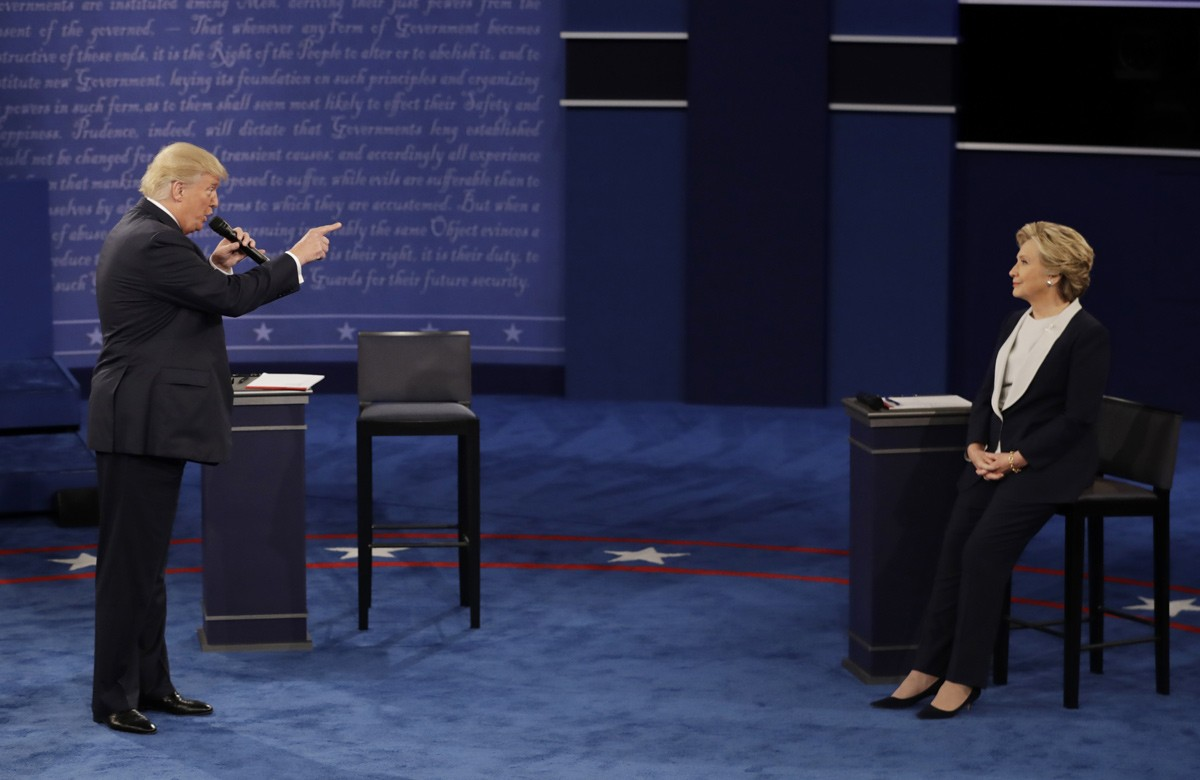 Republican presidential nominee Donald Trump speaks to Democratic presidential nominee Hillary Clinton during the second presidential debate at Washington University in St. Louis, on Oct. 9, 2016.