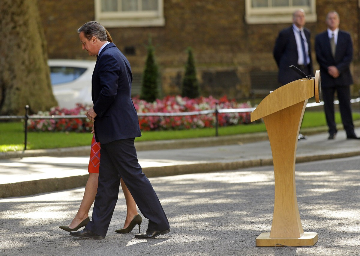 In this Friday, June 24, 2016 file photo, Britain's Prime Minister David Cameron and his wife Samantha walk back into 10 Downing Street, London, after he said he would be resigning in the wake of Britain's vote to leave the European Union after a bitterly divisive referendum campaign. So-called Brexit was one of the biggest business stories in 2016 prompting volatility in financial markets, including a sharp drop in the value of the British pound.
