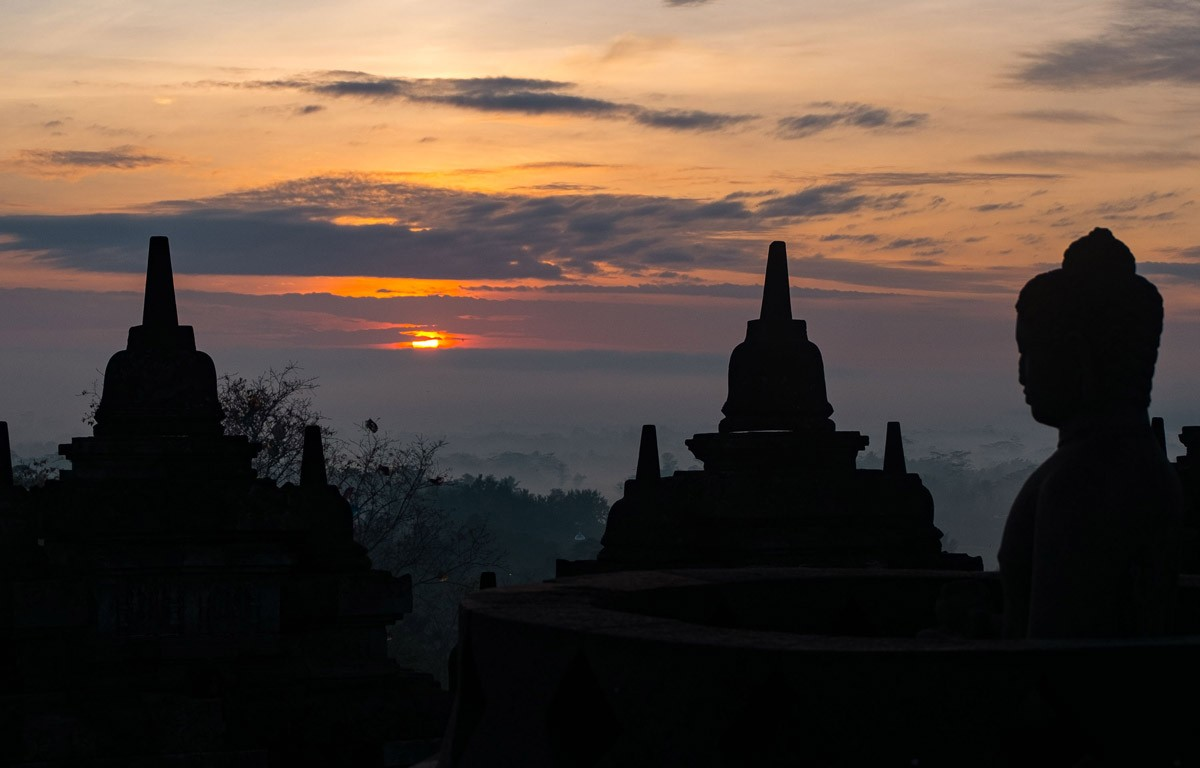 Thousands of people watch the first sunrise of 2017 appear at the peak of Borobudur temple in Central Java on Sunday morning. JP/Tarko Sudiarno