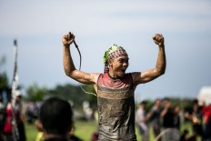 The winning jockey celebrates his victory after a buffalo race in Kaliakah village in Jembrana. JP/ Agung Parameswara