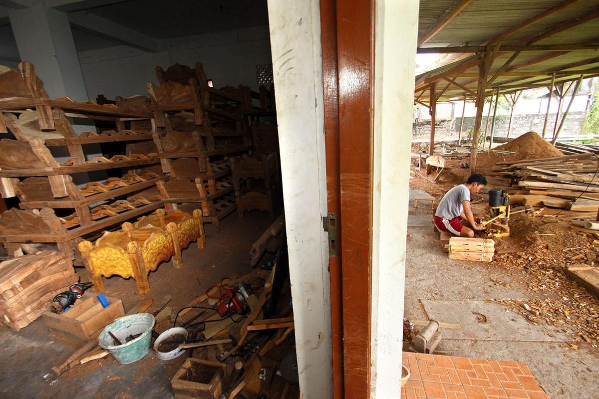 A worker makes the wooden racks for gamelan sets. JP/Aditya Sagita