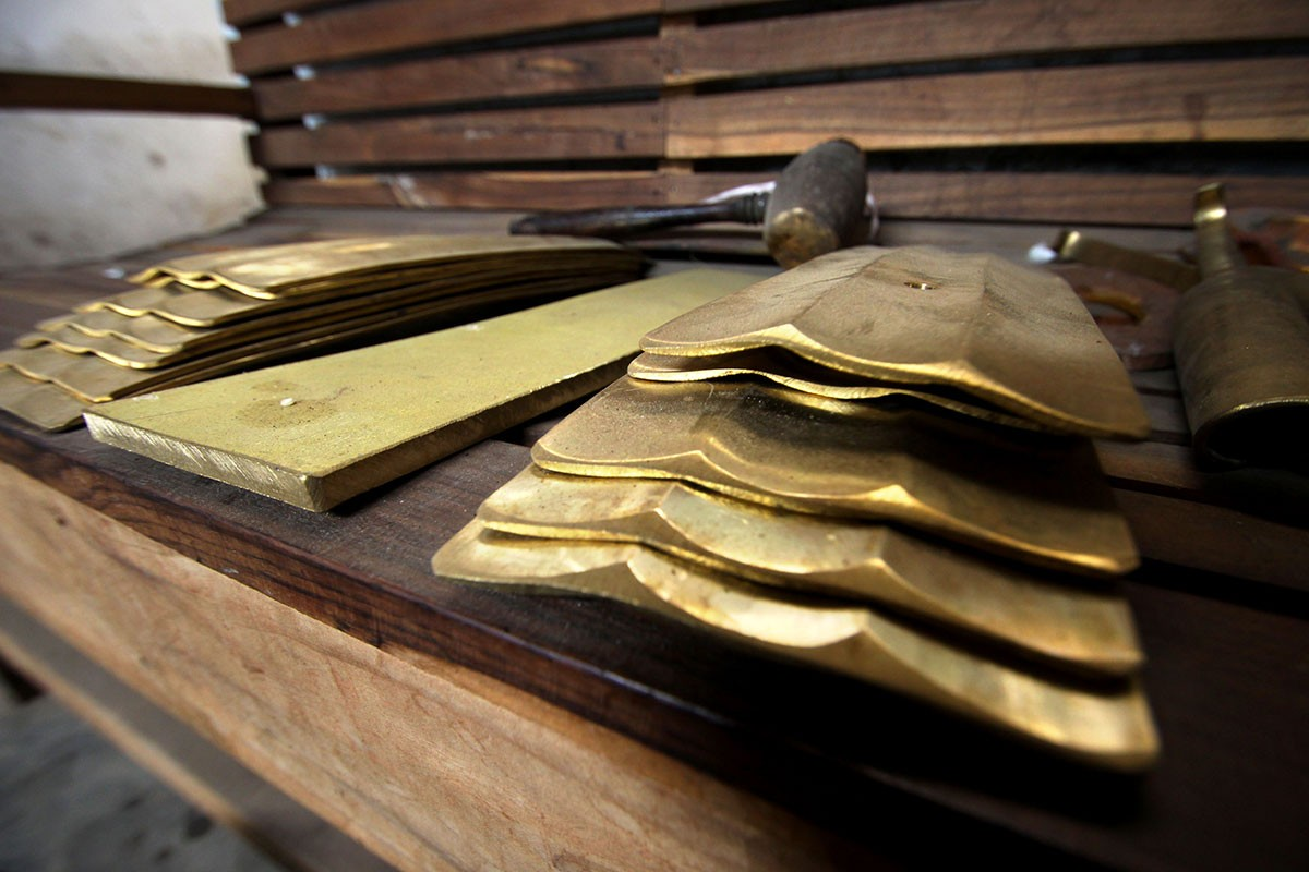 Bars of saron and gambang lay on a table in the Daliyono Legiono workshop. JP/Aditya Sagita