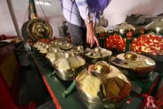 A buyer checks out the gamelan sets at the workshop. JP/Aditya Sagita