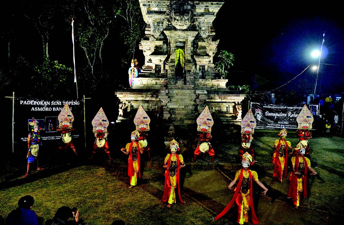 Let the show begin: Dancers appear on stage for the first part of the dance show at Kidal Temple in Malang, East Java. JP/ Aman Rochman