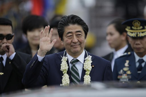 Japan's Abe starts 4-nation trip with visit to Philippines