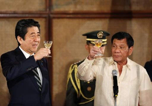 Abe ends Philippine visit with investment, speedboat pledge