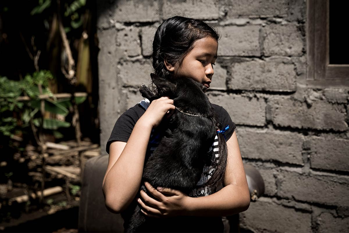 Close to her heart beat: Agung Dewi Laina Pertini, 12, hugs her dog, Salem, in Bangki Lasan Mas village, Ubud, Gianyar, Bali. Gung Dewi got the dog two years ago when she was sick. They have not been parted since then. JP/ Agung Parameswara