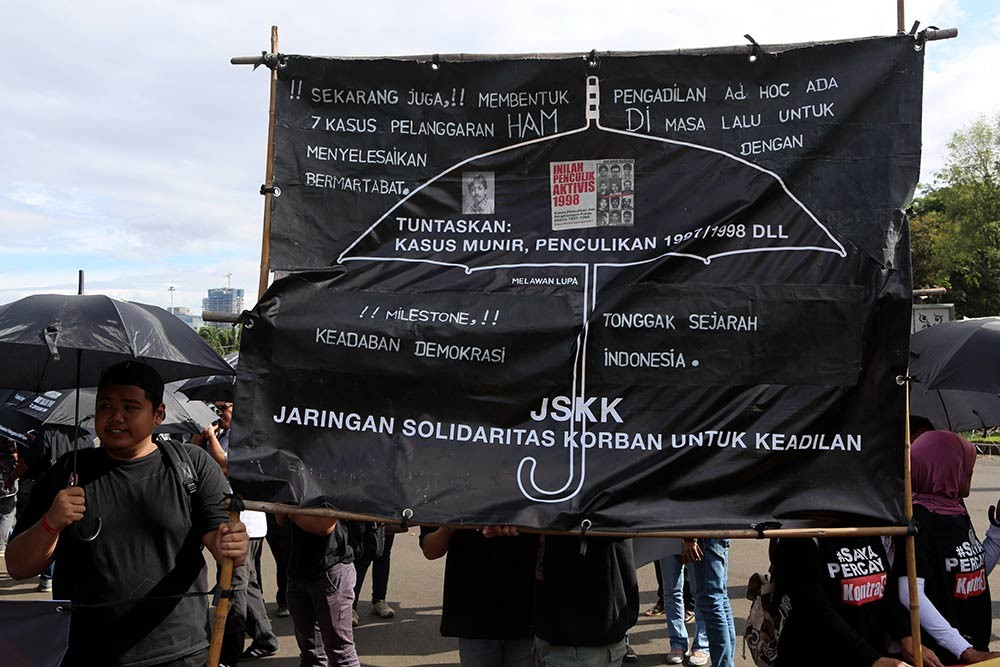 Activists participate in the 10th commemoration of the Kamisan silent protest in front of the Presidential Palace in Jakarta on Jan. 19. The 477th Kamisan marks the 10th year since the first protest in 2007 asking the government to resolve past human rights violations. JP/Seto Wardhana.