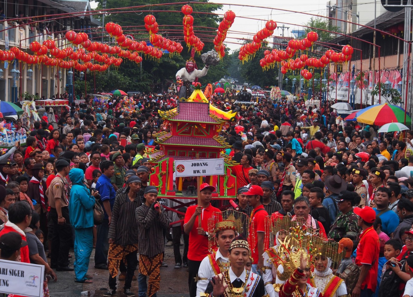 A parade passes through the Pasar Gede area as part of the Grebeg Sudiro tradition on Jan. 22.