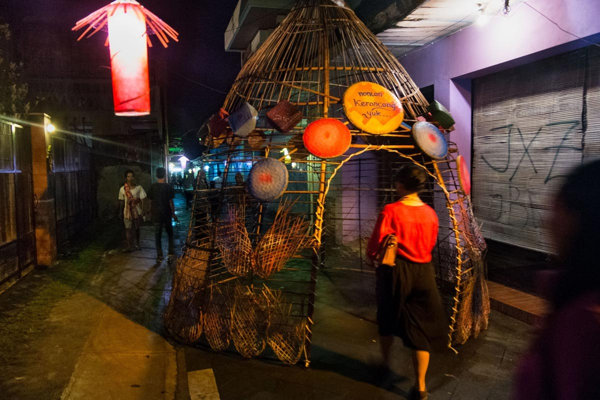 A bamboo installation serves as a small tunnel on the main ally of Kotagede in Yogyakarta during the Keroncong Market music festival in December. JP/ Tarko Sudiarno