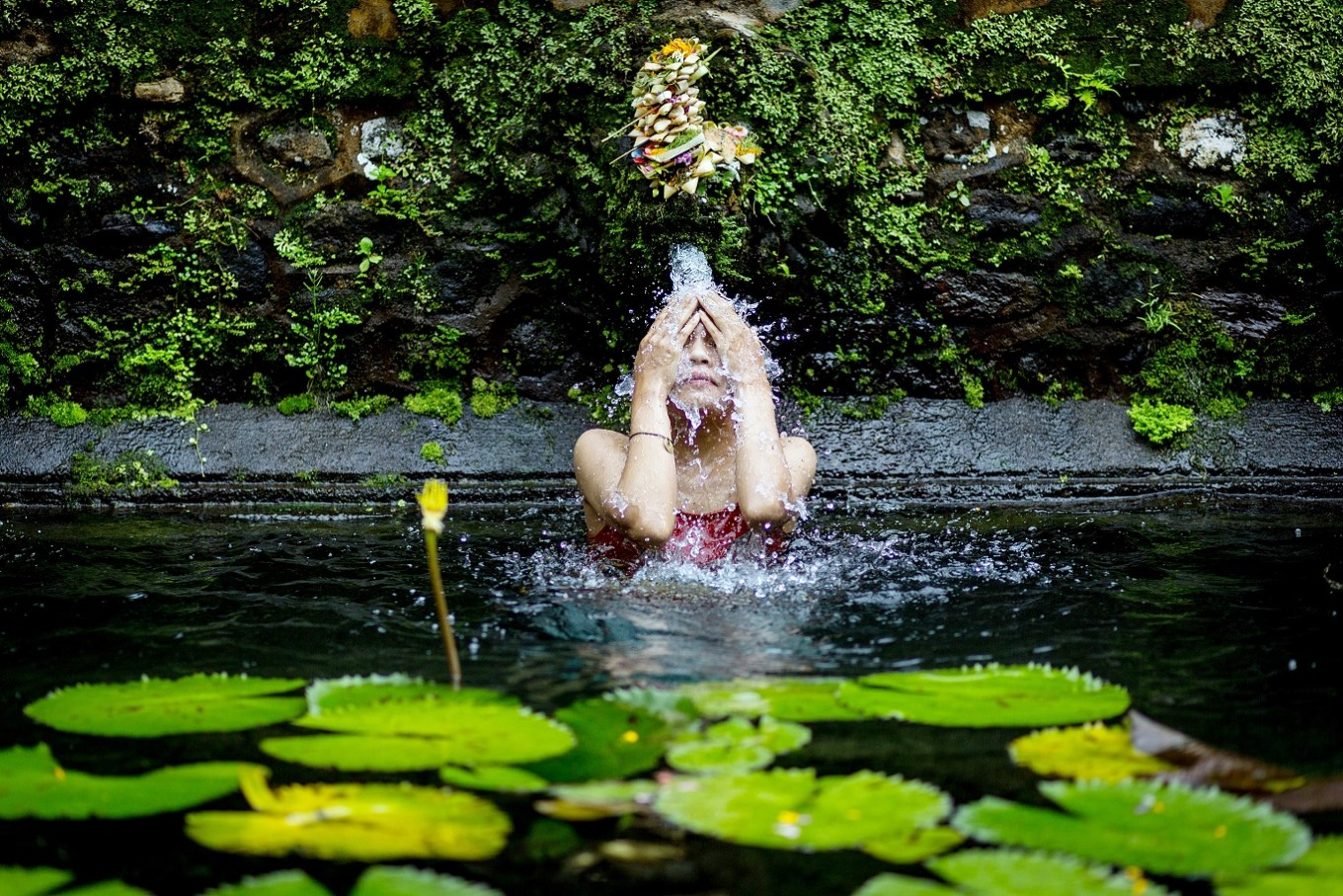 Body rinse: A Balinese woman cleans her body at the Gunung Kawi holy spring.