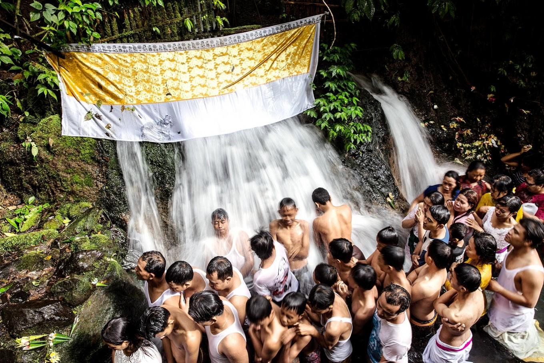 Spiritual shower: Balinese Hindu queue to perform melukat during the Banyu Pinaruh ritual at the holy Sebatu waterfall.