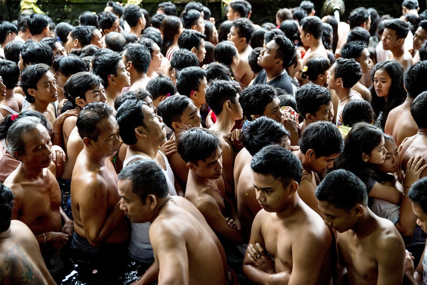 Waiting game: Hundreds of Balinese Hindu people queue in a pool at the holy Tirta Empul spring on Jan. 22 in Gianyar, Bali.