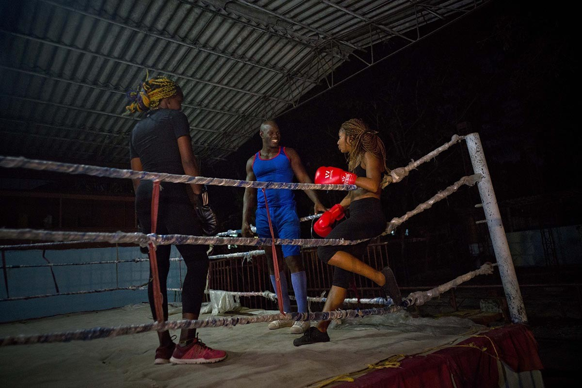 In this Jan. 24, 2017 photo, Olympic silver medalist Emilio Correa Jr., center, instructs Idamerys Moreno, right, and Legnis Cala, at a sports center in Havana, Cuba. Once when the women were kicked out a of boxing gym, Correa Jr. stepped in to help some of them find another gym while they push top Cuban officials to support female boxing. AP/Ramon Espinosa