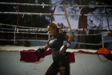 In this Jan. 24, 2017 photo, boxer Legnis Cala poses for a photo before a training session, at a sports center in Havana, Cuba. Women were first allowed to box at the Olympics during the 2012 Summer Olympics but they are still not allowed to box in Cuba. AP/Ramon Espinosa