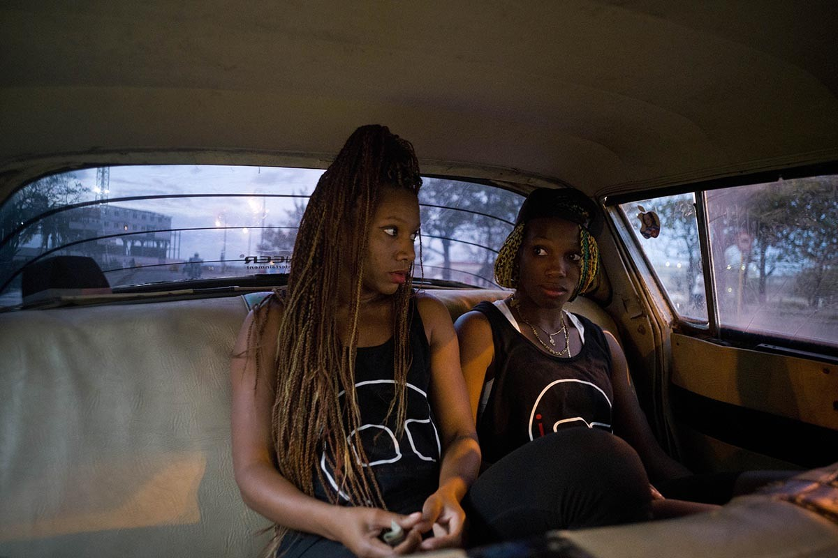 In this Jan. 30, 2017 photo, boxers Idamerys Moreno, left, and Legnis Cala, ride home in a taxi after training, in Havana, Cuba. Female athletes in Cuba have made strides in many other sports, including wrestling, judo and most recently, weightlifting, but not in boxing. AP/Ramon Espinosa