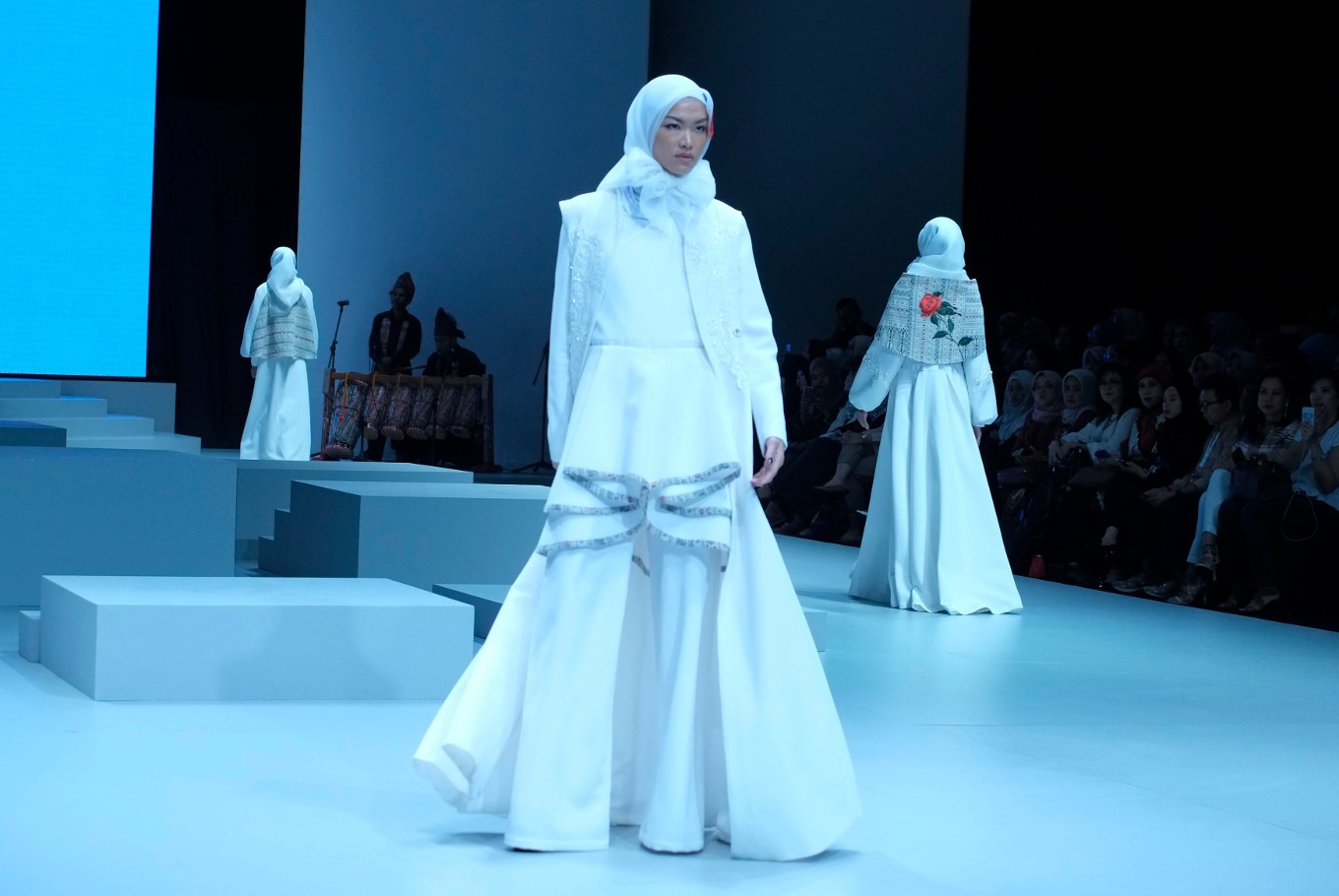 Indonesian designer Jeny Tjahyawati presents an a-l white dress to Indonesia Fashion Week 2017. (JP/Jerry Adiguna).