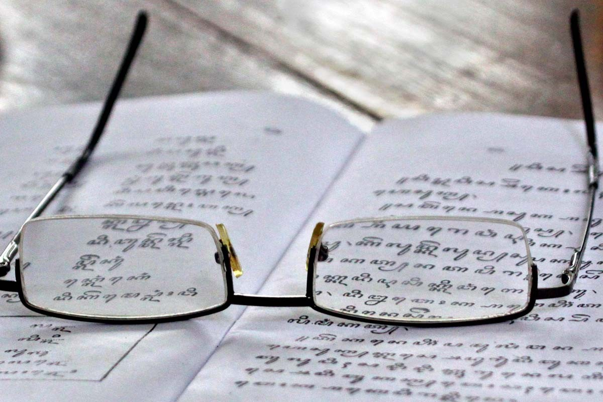 A pair of glasses belonging to a student lay on a textbook on Javanese script. Most of the palace servants are old and wear reading glasses. JP/ Aditya Sagita