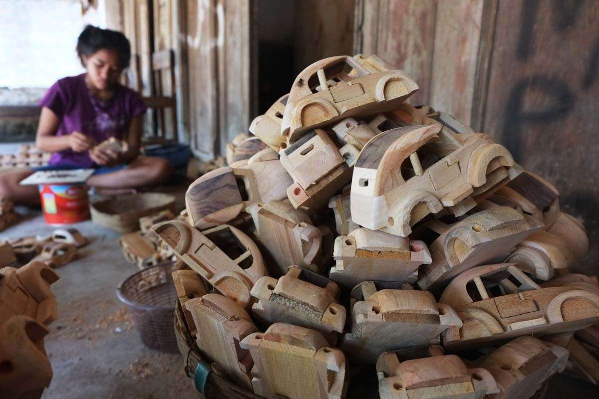A villager crafts a wooden miniature of the Volkswagen Beetle in the village of Wates in Karanganom district, Klaten, Central Java. The products are sold to customers in countries as far as Iran and Turkey. JP/ Ganug Nugroho Adi