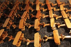 Airplane miniatures are arranged neatly, ready to be packaged and sold. JP/ Ganug Nugroho Adi