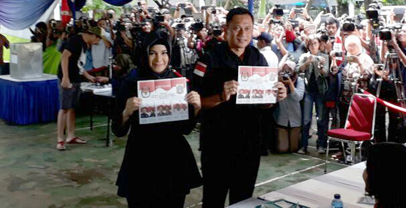 Agus and wife Anissa vote in Kebayoran Baru