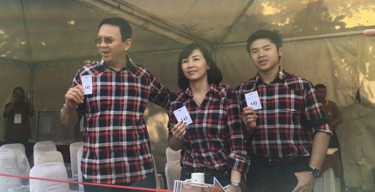 Ahok and family cast votes at Pluit