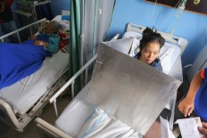 A patient at Tarakan Hospital, Central Jakarta, casts a vote from her bed. The General Elections Commission (KPU) has provided mobile polling stations to meet the needs of hospitalized voters. JP/Seto Wardhana