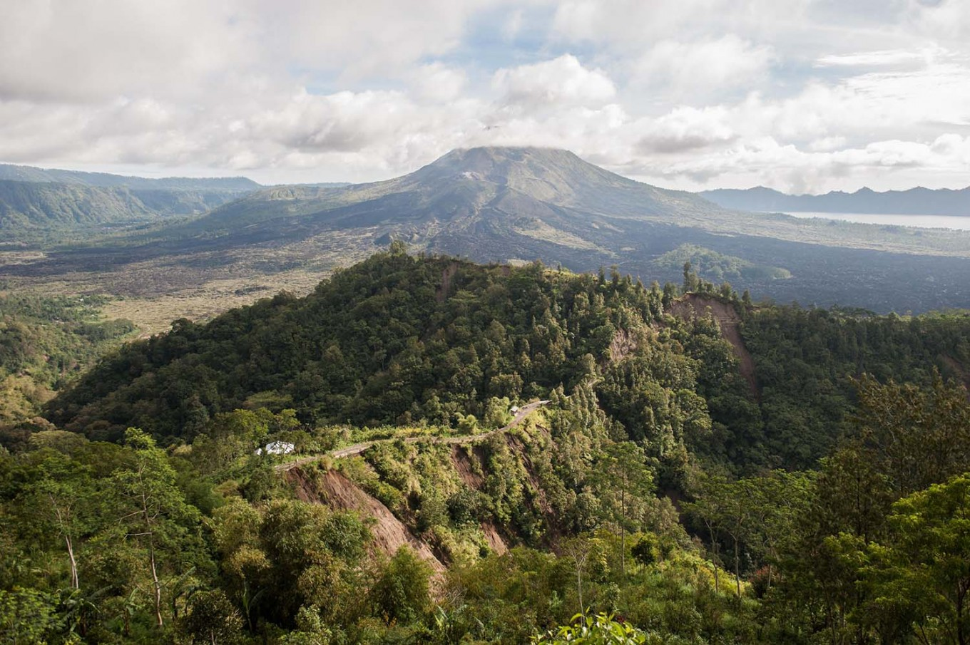 An aerial view of Mount Batur and the main road to Payang village, Kinatamani, Bali, which was struck by a landslide last week. Landslides also occurred in other villages, such as Bantas, Tabu, Yeh Mampeh, Culali, Tukad and Alengkong, captured from the top on Monday, February 13, 2017. JP/ Anggara Mahendra