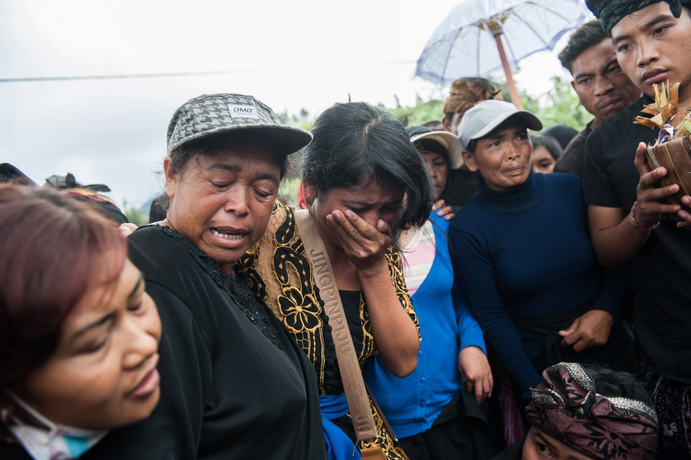 A woman cries during a burial in Songan village on Monday, February 13, 2017. JP/ Anggara Mahendra