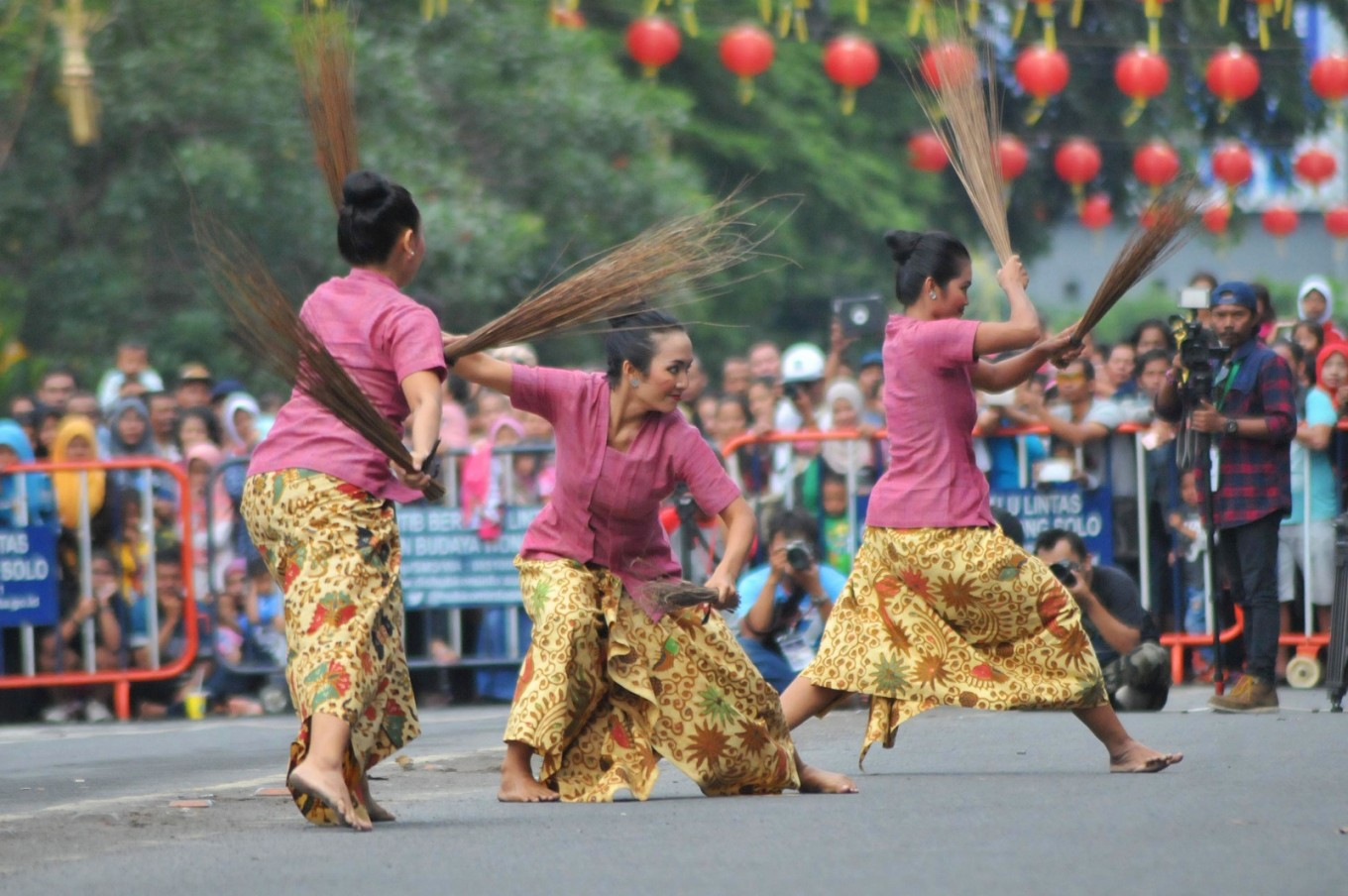 Women perform the Gotong Royong (mutual cooperation) dance as part of the Adeging Kutha Sala colossal dance.