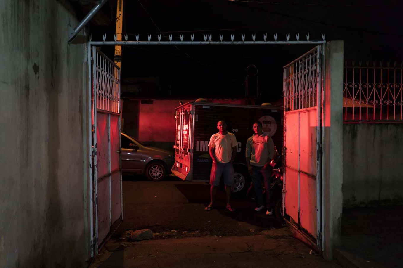 "In this Feb. 5, 2017 photo, residents watch police inspect a home where a woman was shot to death in Manaus, Brazil. ""Citizens are the ones who are truly jailed these days,"" said Claudio Lamachia, head of Brazil's bar association. ""Members of the crime gangs are dictating the rules and stopping people from leaving their homes."" AP Photo/Felipe Dana"