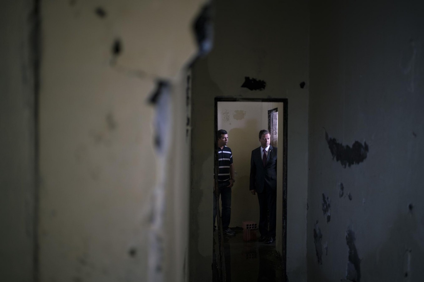 "In this Feb. 2, 2017 photo, Claudio Lamachia, head of Brazil's Bar Association, right, stands in a cell where several inmates were killed at the Anisio Jobim penitentiary complex, known by its Portuguese acronym of Compaj, in Manaus, Brazil. ""Our prisons are universities of crime and we are financing drug gangs inside the prisons by overcrowding them,"" he said. AP Photo/Felipe Dana"
